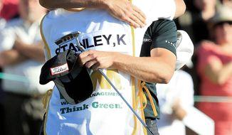 Kyle Stanley (facing camera), hugs caddie Brett Waldman after winning the Phoenix Open, his first PGA Tour victory. (Associated Press)