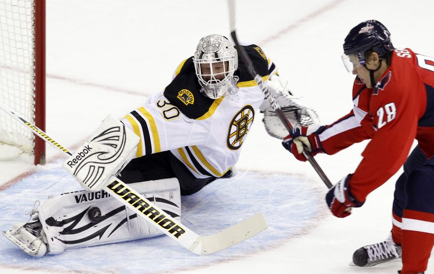 Boston Bruins goalie Tim Thomas deflects a shot by Washington Capitals left wing Alexander Semin during the first period, Sunday, Feb. 5, 2012. (AP Photo/Ann Heisenfelt)