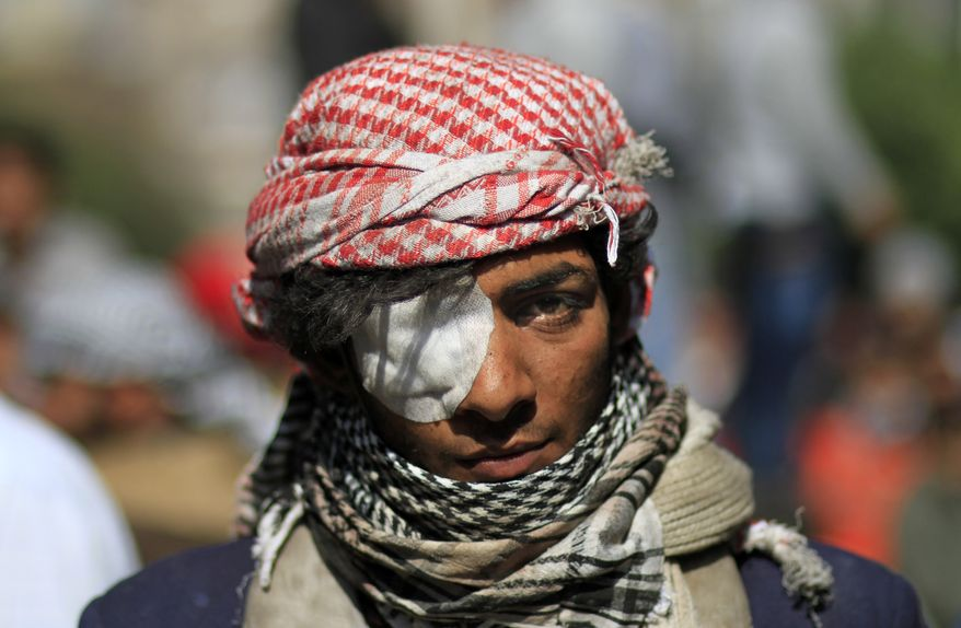 An Egyptian protester looks on during clashes with security forces near the Interior Ministry in Cairo on Saturday, Feb. 4, 2012. (AP Photo/Khalil Hamra)