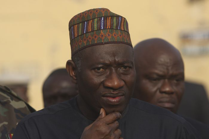 ** FILE ** Nigerian President Goodluck Jonathan visits the police headquarters hit by a suicide bomber in Kano, Nigeria, on Sunday, Jan. 22, 2012. (AP Photo/Sunday Alamba)