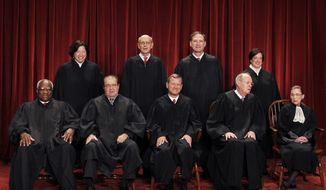 Sitting on the U.S. Supreme Court are (clockwise from upper left) Associate Justices Sonia Sotomayor, Stephen G. Breyer, Samuel A. Alito Jr., Elena Kagan, Ruth Bader Ginsburg and Anthony M. Kennedy; Chief Justice John G. Roberts Jr.; and Associate Justices Antonin Scalia and Clarence Thomas. (AP Photo/Pablo Martinez Monsivais)