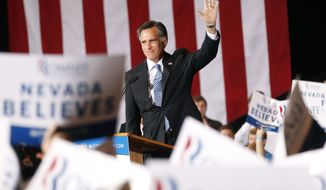 Republican presidential candidate Mitt Romney greets supporters at his Nevada caucus victory celebration in Las Vegas on Saturday, Feb. 4, 2012. (AP Photo/Gerald Herbert)