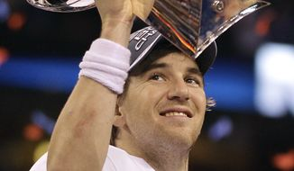 New York Giants quarterback Eli Manning holds up the Vince Lombardi Trophy while celebrating his team's 21-17 win over the New England Patriots in the Super Bowl XLVI, Sunday, Feb. 5, 2012, in Indianapolis. (AP Photo/Matt Slocum)