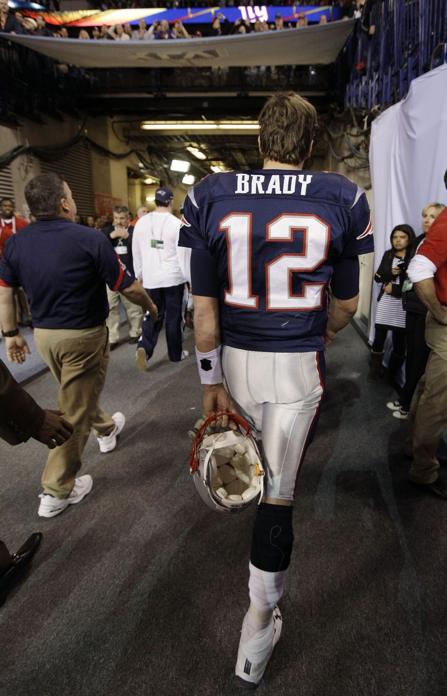 New England Patriots quarterback Tom Brady walks off the field after the Patriots lost to the New York Giants 21-17 in Super Bowl XLVI on Sunday, Feb. 5, 2012, in Indianapolis. (AP Photo/Paul Sancya)