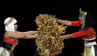 Nicki Minaj (left) and M.I.A. perform during halftime of the Super Bowl game on Sunday. M.I.A., a British hip-hop artist, made an obscene gesture during the performance. (Associated Press)
