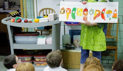 Teacher Nancy Henderson instructs students about fruit snacks during a lesson in healthy eating at Northeast Elementary School, in Danville, Ill. Northeast offers no junk food for sale to its students, but a new study found that almost half the nation's elementary schools do provide it.  (Associated Press)