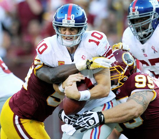 **FILE** New York's Super Bowl season got off to a rocky start when quarterback Eli Manning and the Giants were squeezed by the Redskins 28-14 in Week 1 of the 2011 season, the first of Washington's two wins over New York. (Associated Press)