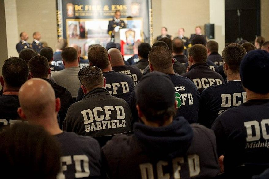 Firefighters listen to Chief Kenneth Ellerbe's State of the Department speech Jan. 24, at the Martin Luther King Jr. Memorial Library. About 100 walked out to protest shift and uniform changes. A spokesman has used social media to call their actions racist. (Barbara L. Salisbury/The Washington Times)