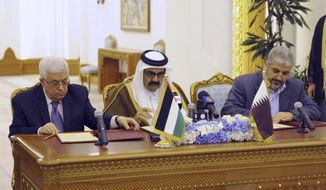 ** FILE ** Palestinian President Mahmoud Abbas (left) and Khaled Mashaal (right), chief of the Islamic militant group Hamas, sit with Qatar's crown prince, Sheik Tamim Bin Hamad Al Thani, as they sign a reconciliation agreement in Doha, Qatar, on Monday, Feb. 6, 2012. (AP Photo/Thaer Ghanaim, Palestinian President's Office)