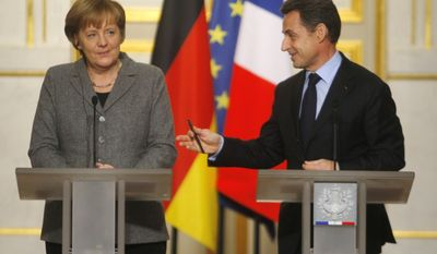 German Chancellor Angela Merkel (left) and French President Nicolas Sarkozy give a joint press conference after a French-German Cabinet meeting at the Elysee Palace in Paris on Monday, Feb. 6, 2012. (AP Photo/Michel Euler)