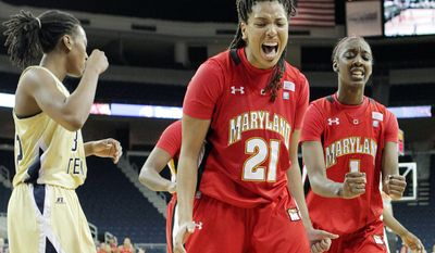 Maryland's Tianna Hawkins, center, and Laurin Mincy, right, react while Georgia Tech forward Chelsea Regins walks off the court during the Terrapins' 64-56 win at the Arena at Gwinnett in Duluth, Ga., Monday, Feb. 6, 2012. (AP Photo/Atlanta Journal-Constitution, Curtis Compton)
