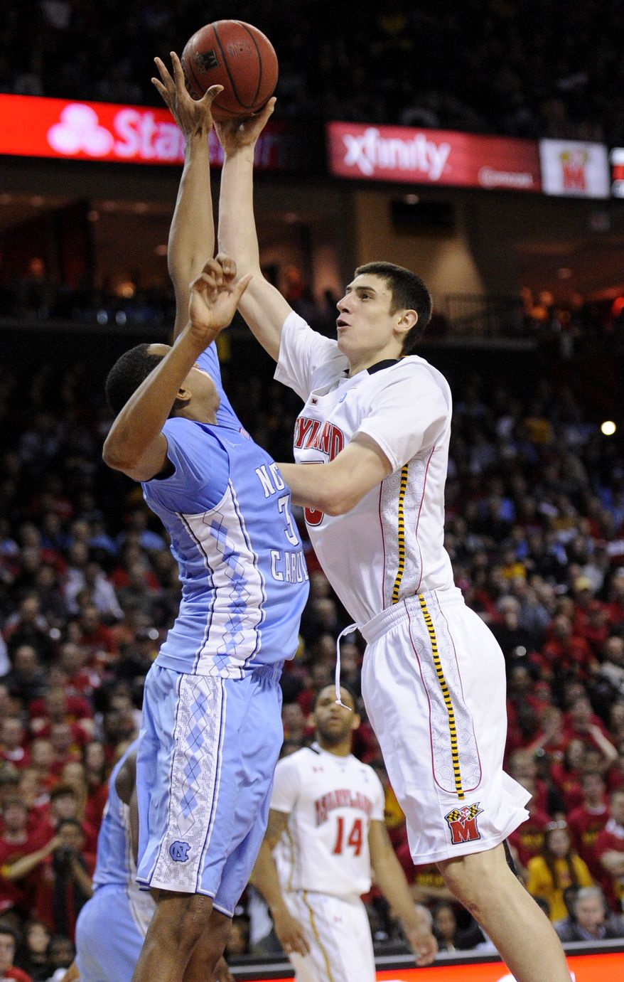 Maryland center Alex Len, right, goes to the basket against North Carolina forward John Henson, during the second half of an NCAA basketball game, Saturday, Feb. 4, 2012, in College Park, Md. North Carolina won 83-74. (AP Photo/Nick Wass)