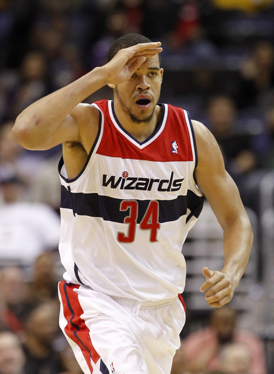 Washington Wizards' JaVale McGee celebrates after scoring during the first half of an NBA game against the Toronto Raptors, Monday, Feb. 6, 2012, in Washington. (AP Photo/Haraz N. Ghanbari)