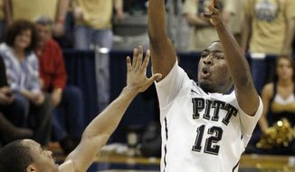 Pittsburgh's Ashton Gibbs (12) releases a 3-point shot over Villanova's Maalik Wayns (2) in the first half of an NCAA basketball game Sunday, Feb. 5, 2012, in Pittsburgh. (AP Photo/Keith Srakocic)