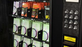 A Shippensburg University vending machine provides an emergency contraceptive pill for $25 along with condoms and pregnancy tests. (Associated Press)