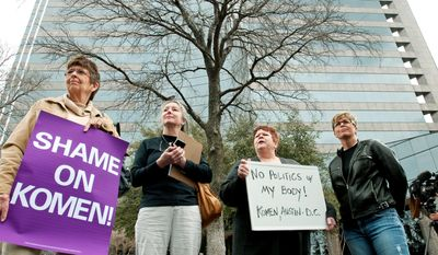 Protesters (from left) Jeanne Owers, Pat Hale, Kris Martin and Dawn Miefert stand outside the Susan G. Komen for the Cure headquarters in Dallas. Komen executive Karen Handel (below) resigned Tuesday. (Associated Press)