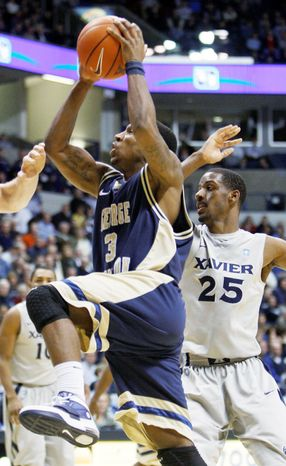 George Washington point guard Tony Taylor, shown against Atlantic 10 rival Xavier, has averaged 21 points the past three games. (Associated Press)