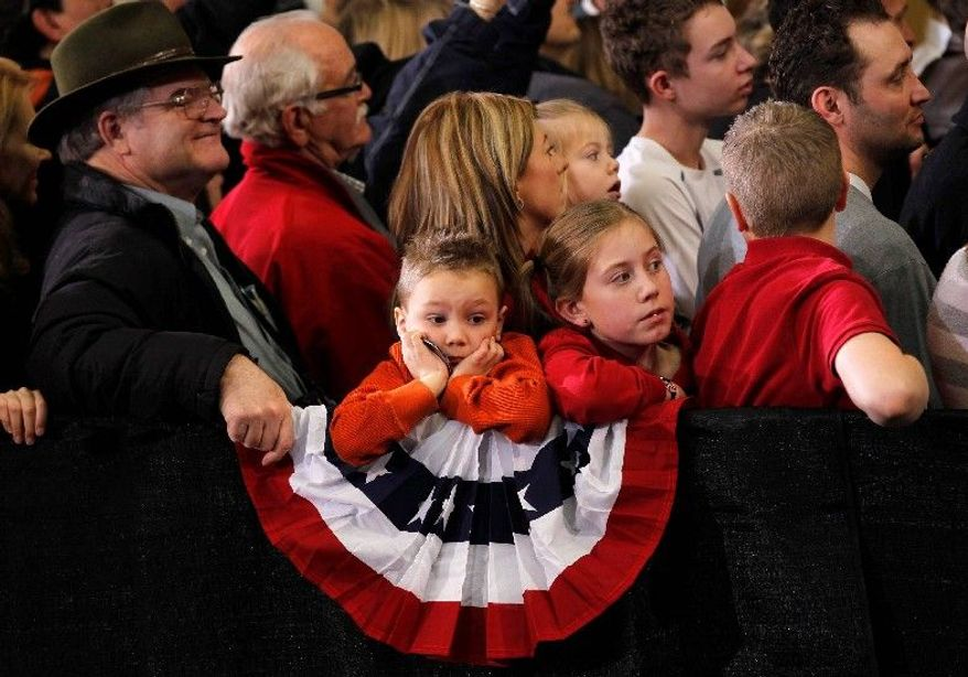 BIG MOMENT: Children wait to shake hands with Republican presidential candidate Mitt Romney at a campaign rally in Loveland, Colo., on Tuesday, a day for caucuses in Colorado and Minnesota. Critics say it's time to take a look at the value of caucuses. (Associated Press)