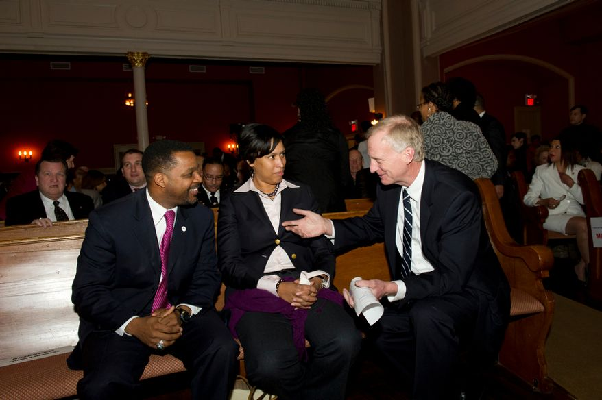 Washington D.C. Council Chairman Kwame Brown (left) chats with Councilmembers Muriel Bowser (Ward 4, center) and Jack Evans (Ward 2, right) as they await the arrival of Washington D.C. Mayor Vincent C. Gray, for the 2012 State of the District Address at the Sixth and I Historic Synagogue in Washington, D.C., Tuesday, February 7, 2012. (Rod Lamkey Jr/ The Washington Times)