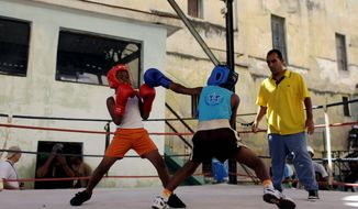 "Lazaro Perez (right center), 9, recently became Havana's first under-75-pound champion for 9- and 10-year-olds. ""I'm not afraid. I'm fast, and I really like it."" Perez says of his love for the sport. (Associated Press)"
