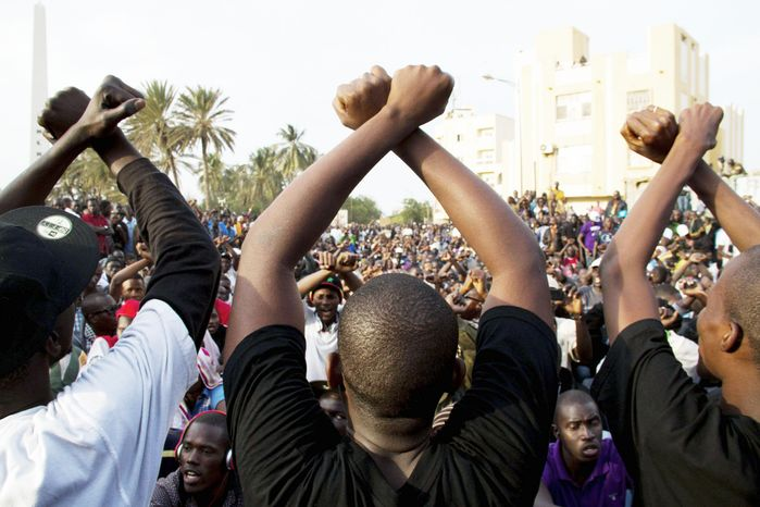 People opposed to Mr. Wade remaining in office gathered in Dakar on Jan. 31 to protest the court ruling allowing the nation's elderly leader to run for a third term. (Associated Press)