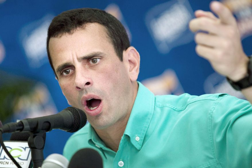 Henrique Capriles Radonski, governor of Miranda state, looks like the favorite to win Sunday's opposition primary to determine an opponent for President Hugo Chavez in Venezuela's Oct. 7 election. (Associated Press)