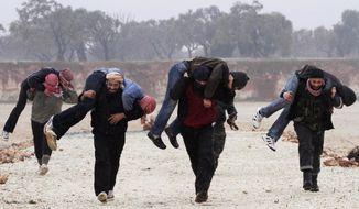 Members of the Free Syrian Army train Feb. 7, 2012, outside Idlib, Syria. (Associated Press)