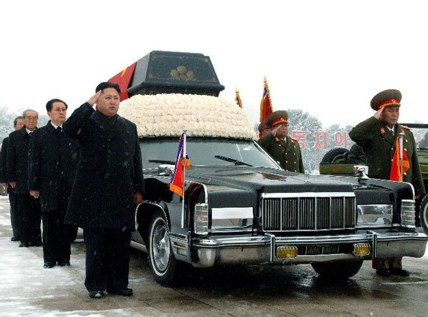 Kim Jong-un (left) salutes beside the hearse carrying the body of his late father and North Korean leader Kim Jong-il during the funeral procession in Pyongyang, North Korea, on Dec. 28. Behind the new leader is his uncle Jang Song-thaek, who is vice chairman of the National Defense Commission. Behind Mr. Jang is top propaganda official Kim Ki-nam and then Workers' Party official Choe Thae-bok (far left, partially hidden). The two military officers are Ri Yong-ho, vice marshal of the Korean People's Army (front right), and People's Armed Forces Minister Kim Yong-chun. (Associated Press)