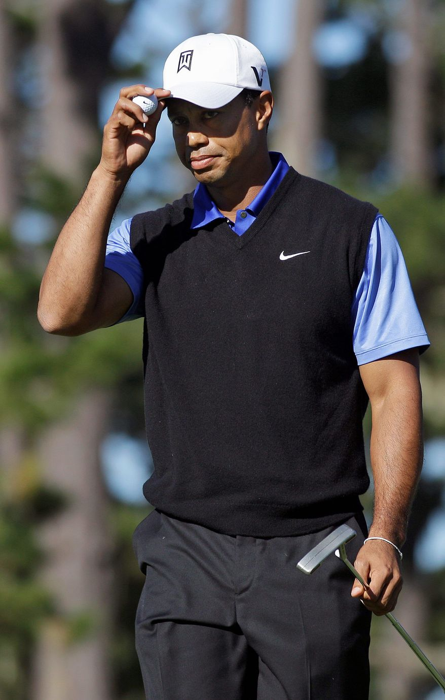associated press Tiger Woods acknowledges the gallery after making a birdie on the 10th hole at Spyglass Hill. He shot a 68, leaving him tied for 15th.