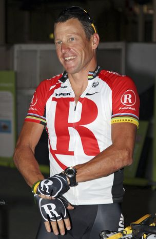 FILE - In this Jan. 24, 2011, file photo, American cyclist Lance Armstrong prepares for a fundraising ride through the streets of Brisbane, Australia. Federal prosecutors said, Friday, Feb. 3, 2012, they are closing a criminal investigation of Armstrong and will not charge him over allegations the seven-time Tour de France winner used performance-enhancing drugs. (AP Photo/Tertius Pickard, File)