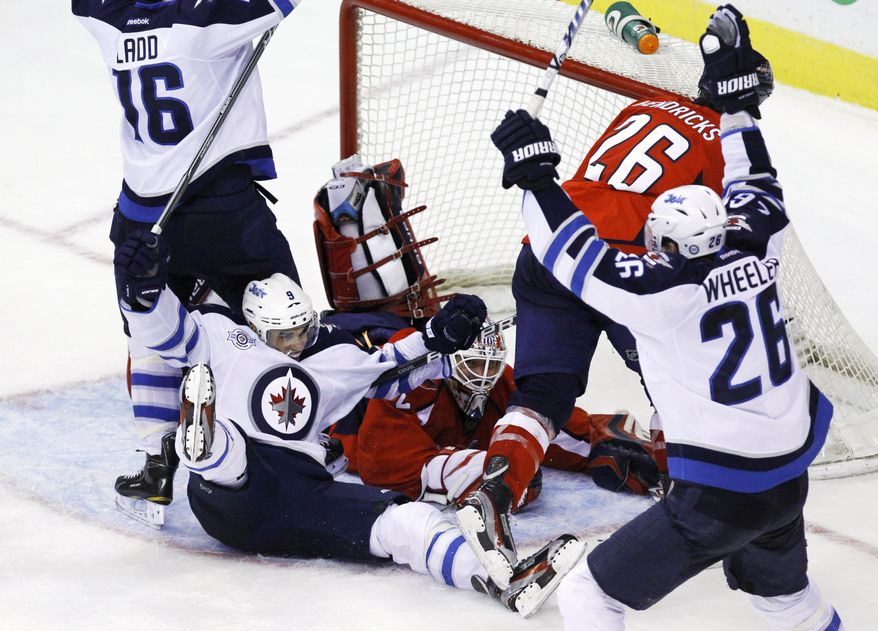 Winnipeg Jets left wing Evander Kane scored his team's first goal at 17:45 of the third period, and then Dustin Byfuglien scored 12 seconds later to tie it up and force overtime. The Jets ultimately won in the shootout, 3-2. (AP Photo/Jacquelyn Martin)