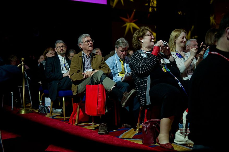 "Members of the audience watch as Virginia Attorney General Ken Cuccinelli accepts the ""Defender of the Constitution Award"" from National Rifle Association President David Keene at the Conservative Political Action Conference (CPAC) held at the Marriott Wardman Park, Washington, DC, Thursday, February 9, 2012. The annual political conference draws thousands of supporters and prominent conservative figures. (Andrew Harnik / The Washington Times)"
