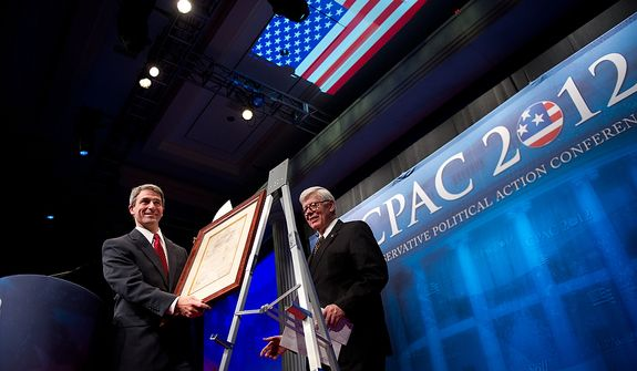 "Virginia Attorney General Ken Cuccinelli, left, accepts the ""Defender of the Constitution Award"" from National Rifle Association President David Keene, center, at the Conservative Political Action Conference (CPAC) held at the Marriott Wardman Park, Washington, DC, Thursday, February 9, 2012. The annual political conference draws thousands of supporters and prominent conservative figures. (Andrew Harnik / The Washington Times)"