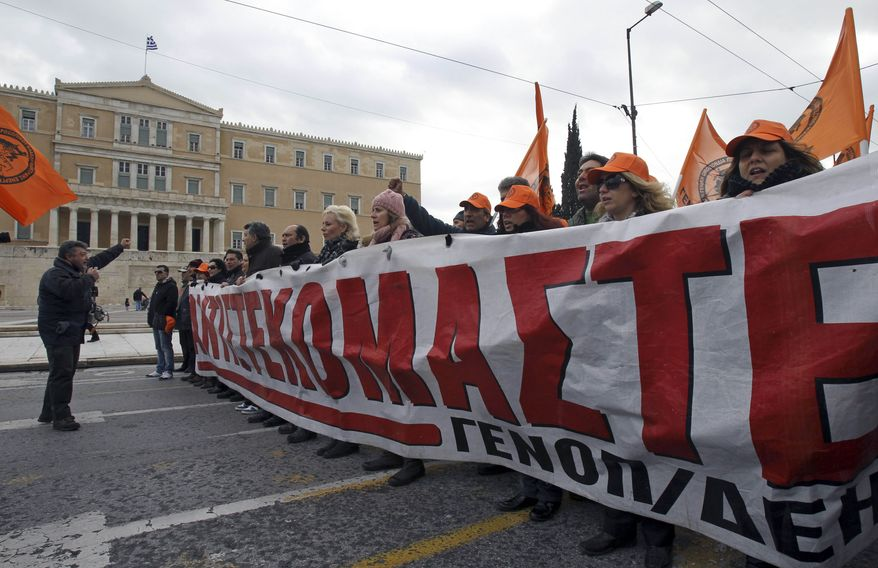 Employees of the electricity utility Public Power Corp. shout slogans in front of the Greek Parliament on Syntagma Square in Athens to protest the Greek government's plans to privatize part of the power distribution service. The banner reads, ''We resist.'' (AP Photo/Thanassis Stavrakis)