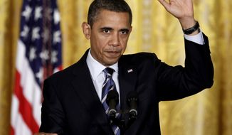 President Barack Obama gestures after speaking about No Child Left Behind, Thursday, Feb. 9, 2012, in the East Room of the White House in Washington. (AP Photo/Pablo Martinez Monsivais)