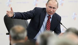 Russian Prime Minister Vladimir Putin, who is running for his former job as president, addresses a conference of the Union of Industrialists in Moscow on Thursday, Feb. 9, 2012. (AP Photo/Ivan Sekretarev)