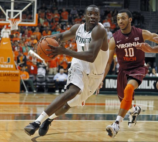 Miami's Durand Scott drives past Virginia Tech's Marquis Rankin during the first half Thursday, Feb. 9, 2012, in Coral Gables, Fla. (AP Photo/Miami Herald, Carl Juste) MAGS OUT
