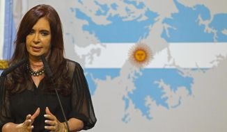 Argentine President Cristina Fernandez speaks Feb. 7, 2012, during a national address while standing in front of a Falklands Islands' map at Government Palace in Buenos Aires. (Associated Press)
