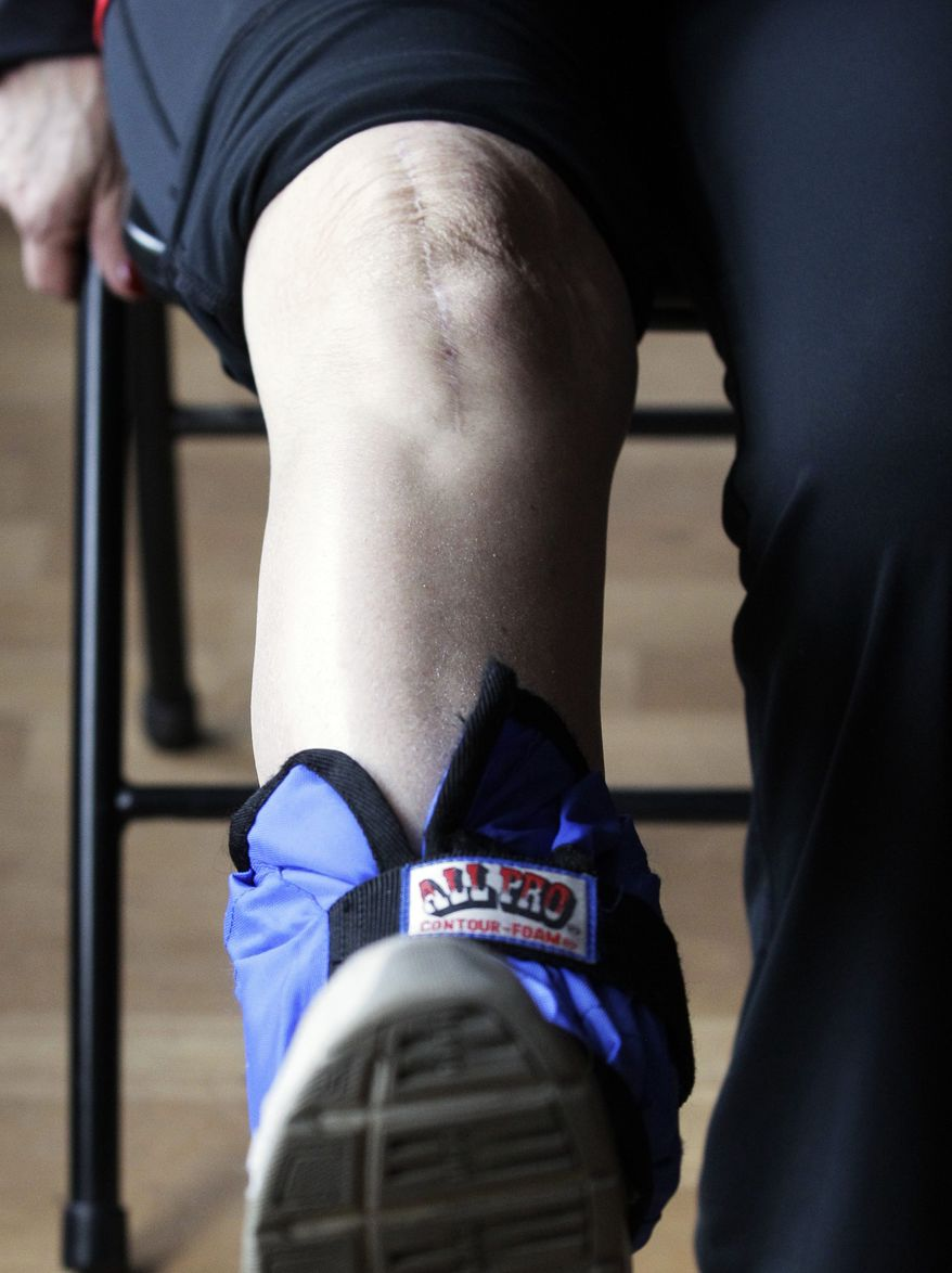 Donna Brent, 63, works out her leg at her home in Deerfield, Ill., on Feb. 4, 2012. When knee pain started getting in the way of some of her sports, she gave in to her doctor's advice and had a knee replacement operation last June on her right knee. (Associated Press)