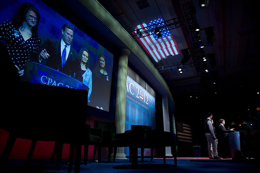 Republican presidential candidate and former Pennsylvania Sen. Rick Santorum, surrounded by his family, speaks Feb. 10, 2012, after speaking at the Conservative Political Action Conference (CPAC) in Washington. (Andrew Harnik/The Washington Times)