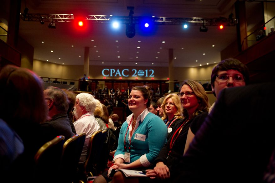 A supporter listens to Republican Presidential Candidate and former Massachusetts Gov. Mitt Romney speak at the Conservative Political Action Conference (CPAC) held at the Marriott Wardman Park, Washington, D.C., Friday, February 10, 2012. The annual political conference draws thousands of supporters and prominent conservative figures. (Andrew Harnik/The Washington Times)