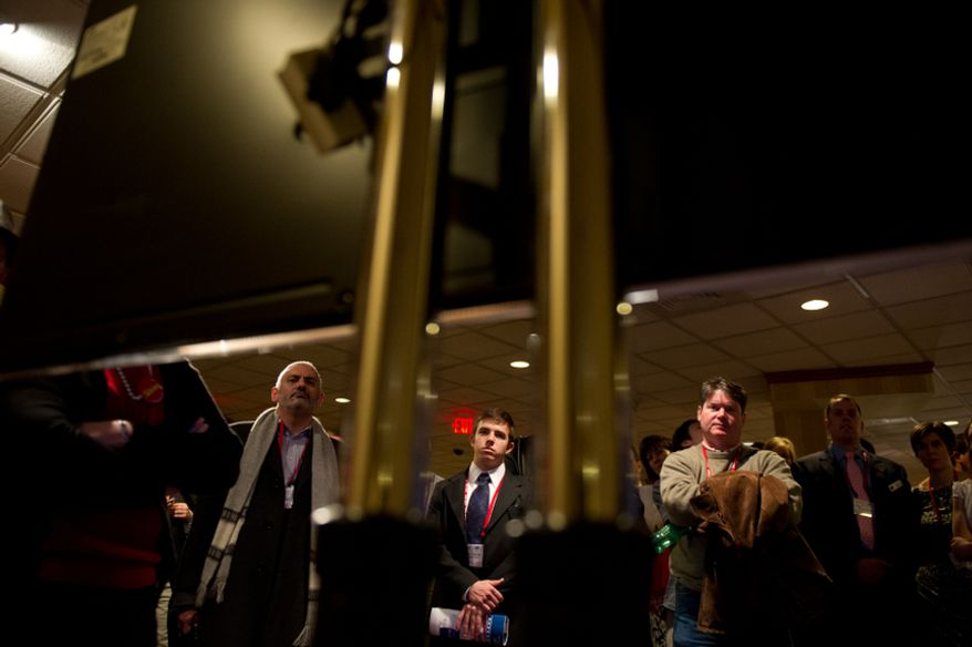 Left to right: Jose Herrera of Madrid, Spain, Chris Chaney of Atlanta, GA, Bruce Majors, of Washington, DC and others watch Conservative Author Ann Coulter speak via television screen from outside the full  capacity main ballroom at the Conservative Political Action Conference (CPAC) held at the Marriott Wardman Park, Washington, D.C., Friday, February 10, 2012. The annual political conference draws thousands of supporters and prominent conservative figures. (Andrew Harnik/The Washington Times)