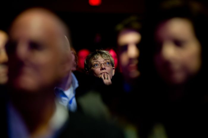 A member of the audience listens to Republican Presidential Candidate and former Massachusetts Gov. Mitt Romney speak at the Conservative Political Action Conference (CPAC) held at the Marriott Wardman Park, Washington, D.C., Friday, February 10, 2012. The annual political conference draws thousands of supporters and prominent conservative figures. (Andrew Harnik/The Washington Times)