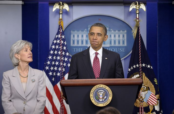** FILE ** President Obama, accompanied by Health and Human Services Secretary Kathleen Sebelius, announces Feb. 10, 2012, at the White House the revamp of his contraception policy requiring religious institutions to fully pay for birth control. (Associated Press)