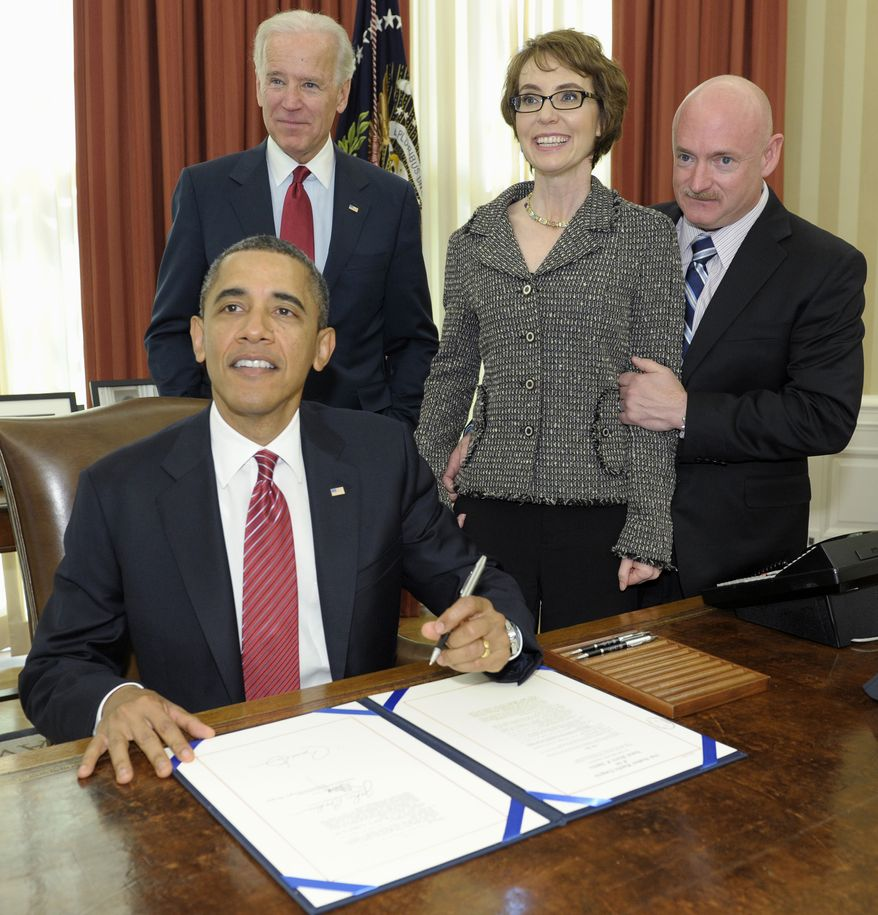 President Obama, accompanied by Vice President Joe Biden, former Arizona Rep. Gabrielle Giffords and her husband Mark Kelly, signs Feb. 10, 2012, the Ultralight Aircraft Smuggling Prevention Act of 2012 in the Oval Office of the White House. The bill, which gives law enforcement greater authority to combat illicit drug trafficking on U.S. borders, is the last piece of legislation that Giffords sponsored and voted on. (Associated Press)