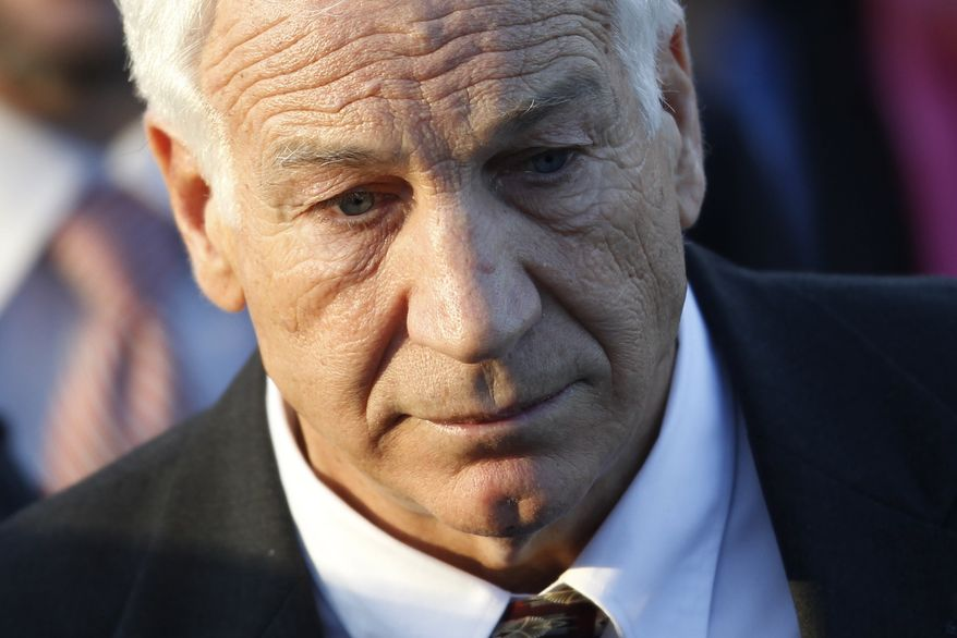 ** FILE ** In this Dec. 13, 2011, photo, former Penn State assistant football coach Jerry Sandusky arrives for a preliminary hearing at the Centre County Courthouse in Bellefonte, Pa. (AP Photo/Matt Rourke)