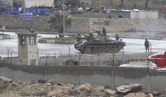** FILE ** A Syrian tank is seen in Idlib, Syria, Thursday, Feb. 9, 2012. (AP Photo)