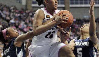 Connecticut's Kaleena Mosqueda-Lewis battles for a rebound against Georgetown's Rubylee Wright, left, and Adria Crawford, right, in the second half in Storrs, Conn., Saturday, Feb. 11, 2012. Mosqueda-Lewis was the top-scorer for Connecticut with 23 points. Connecticut won 80-38. (AP Photo/Jessica Hill)