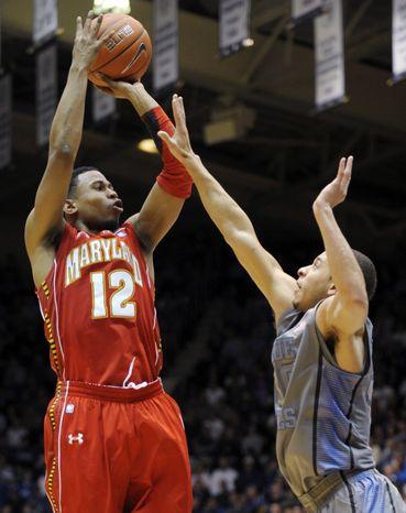 Maryland's Terrell Stoglin shoots over Duke's Seth Curry during the second half Saturday, Feb. 11, 2012, in Durham, N.C. Duke won 73-55. (AP Photo/Sara D. Davis)