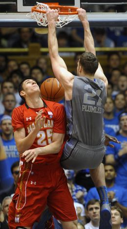 Duke's Miles Plumlee dunks over Maryland's Alex Len during the second half Saturday, Feb. 11, 2012, in Durham, N.C. Duke won 73-55. (AP Photo/Sara D. Davis)